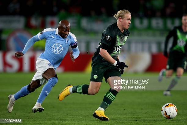 Malmo's Swedish forward Isaac Kiese Thelin and Wolfsburg's Austrian midfielder Xaver Schlager vie for the ball during the Europa League last 32 first...