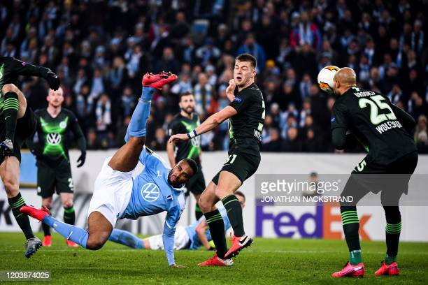 Malmo's Swedish forward Isaac Kiese Thelin kicks the ball during the Europa League Last 32 Second Leg football match Malmo against Wolfsburg on...