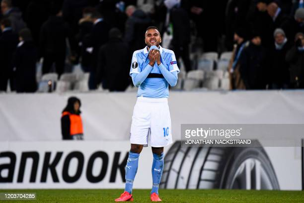 Malmo's Swedish forward Isaac Kiese Thelin reacts after the Europa League Last 32 Second Leg football match Malmo against Wolfsburg on February 27,...