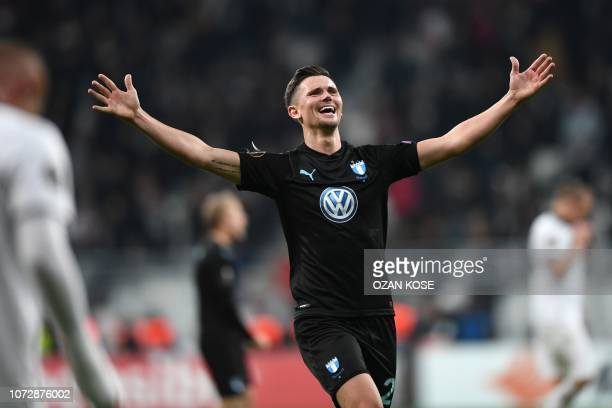 Malmo's Swedish forward Marcus Antonsson celebrates their victory with his fans at the end of the UEFA Europa League Group I football match between...