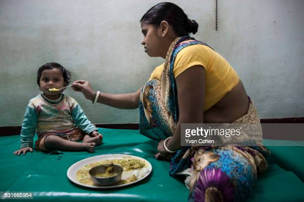 Malnourished child receives supplementary food at a health center run by Calcutta Kids in the Fakir Bagan area of Howrah in Calcutta. Founded in...