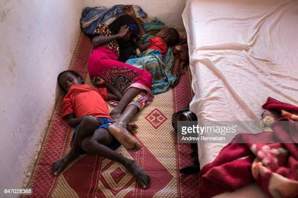 Malnourished children lie on the floor of a government run health clinic on February 24 2017 in Dhudo Somalia Somalia is currently on the brink of...