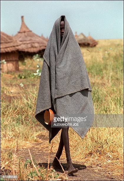 A malnourished man shown in a file photo dated 25 September 1992 walking to get food in the K Maina Untied Nations feeding center in Narsia southern...