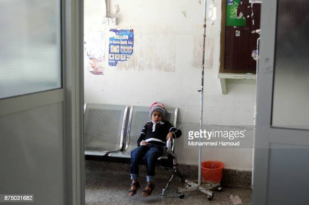 A malnourished Yemeni child sits on a chair as they receive medical treatment amid a spread of malnutrition and risk of famine at a hospital on...