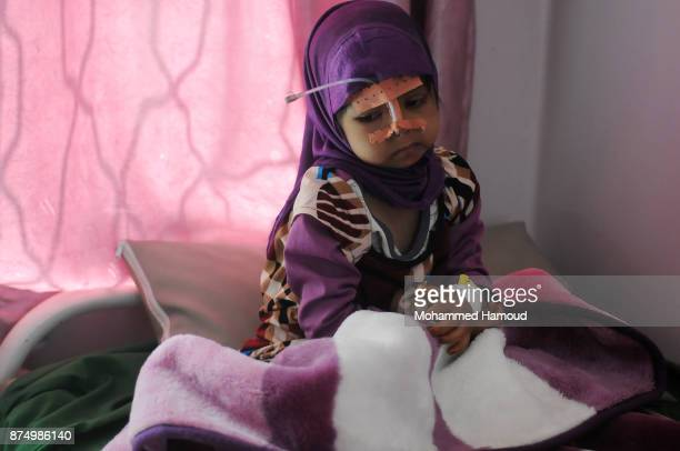 A malnourished Yemeni girl receives medical treatment amid a spread of malnutrition and risk of famine at a hospital on November 15 2017 in Sana'a...