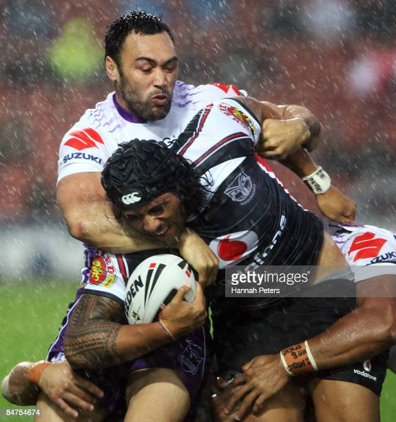 Malo Solomona of the Warriors is tackled by Wairangi Koopu of the Storm during the NRL Trial match between the Warriors and the Melbourne Storm at...