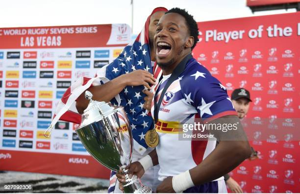 Malon Aljiboori and Carlin Isles of the United States celebrate with the Cup Final trophy after defeating Argentina during the HSBC USA Sevens at Sam...