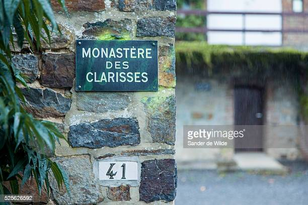 Malonne, Belgium, 26 August 2012. Sign at the entrance of the monastery of the 'Poor Clare Sisters' convent. Graffiti was used as a protest. The...