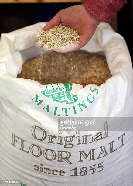 Malt cereal grain, the main botanical ingredient in whisky manufacture, sits in a sack at The London Distillery Company Ltd. Plant in London, U.K.,...