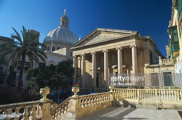 Malta, Mdina, St Pauls Anglican Cathedral with dome of Carmelite Church behind.