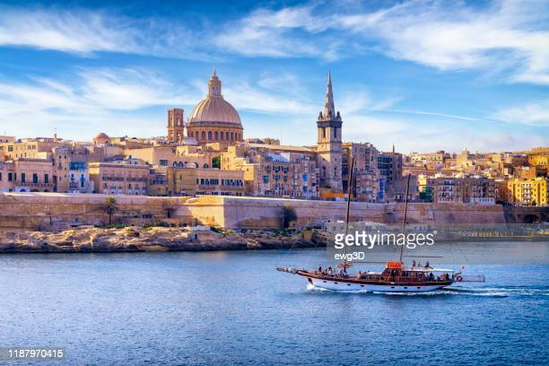 malta - mediterranean travel destination, marsamxett harbour and valletta with cathedral of saint paul - valletta stock pictures, royalty-free photos & images