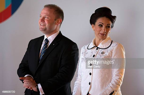Malta Prime Minister Joseph Muscat and his wife Michelle Muscat greet delegates as they arrive at the CHOGM opening ceremony at the Mediterranean...