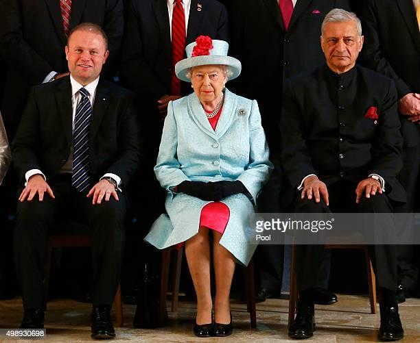 Malta Prime Minister Joseph Muscat Queen Elizabeth II and Commonwealth Secretary General Kamalesh Sharma for the family photo of the Commonwealth...
