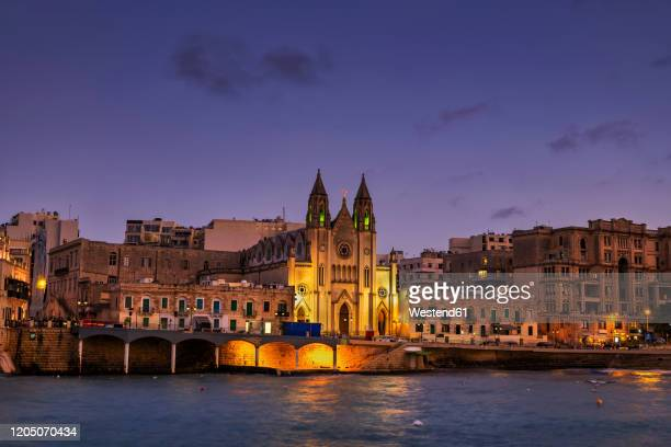 malta, st. julian, town skyline at night with carmelite church at balluta bay - carmelite order stock pictures, royalty-free photos & images