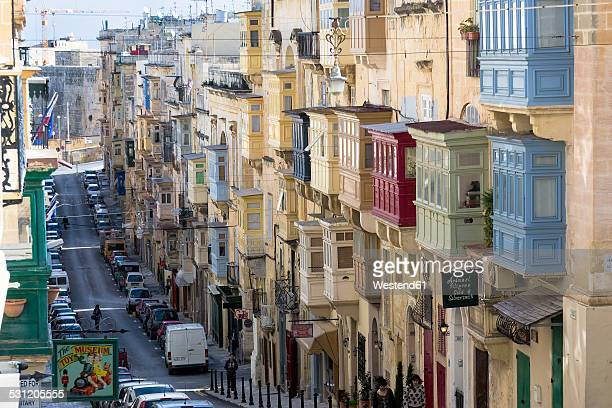 malta, valletta, row of houses with typical balconies - valletta stock pictures, royalty-free photos & images