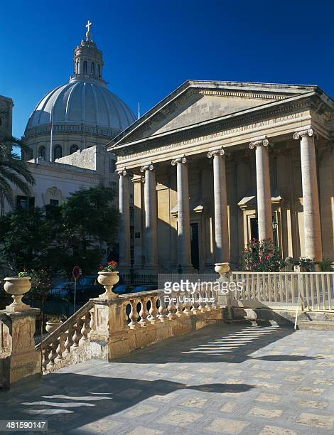 Malta, Valletta, St Pauls Anglian Cathedral with Dome of Carmelite Church behind.