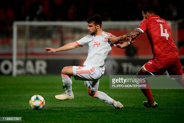 Malta's defender Steve Borg holds off Spain's defender Juan Bernat during the Euro 2020 Group F qualifying football match Malta vs Spain on March 26,...