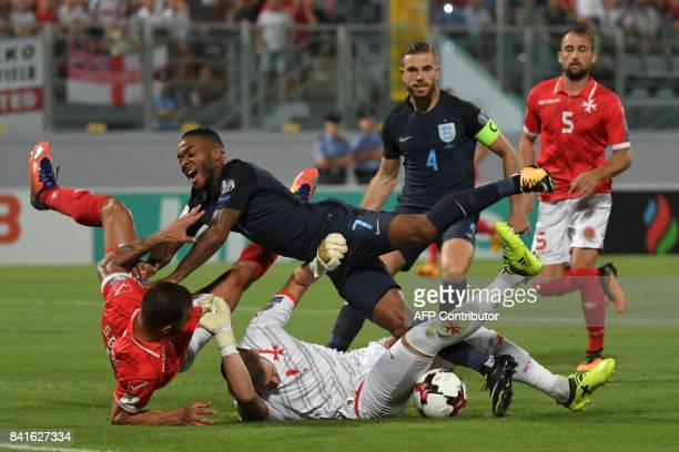 Malta's goalkeeper Andrew Hogg blocks the ball the 2018 FIFA World Cup group F qualifying football match between Malta and England at the National...