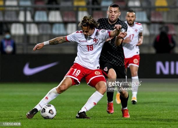 Malta's midfielder Bjorn Kristensen fights for the ball with Croatia's midfielder Mateo Kovacic during the FIFA World Cup Qatar 2022 qualification...