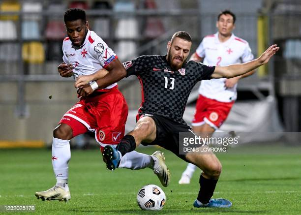 Malta's midfielder Joseph Mbong fights for the ball with Croatia's midfielder Nikola Vlasic during the FIFA World Cup Qatar 2022 qualification Group...