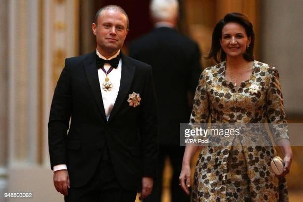 Malta's Prime Minister Joseph Muscat and his wife Michelle arrive to attend The Queen's Dinner during The Commonwealth Heads of Government Meeting at...