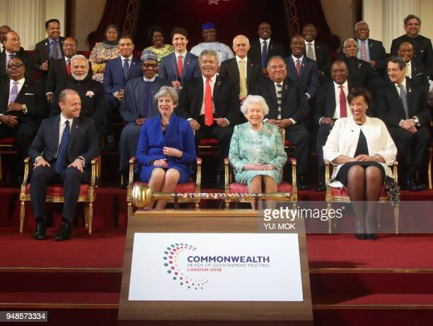 Malta's Prime Minister Joseph Muscat Britain's Prime Minister Theresa May Britain's Queen Elizabeth II and Commonwealth SecretaryGeneral Patricia...