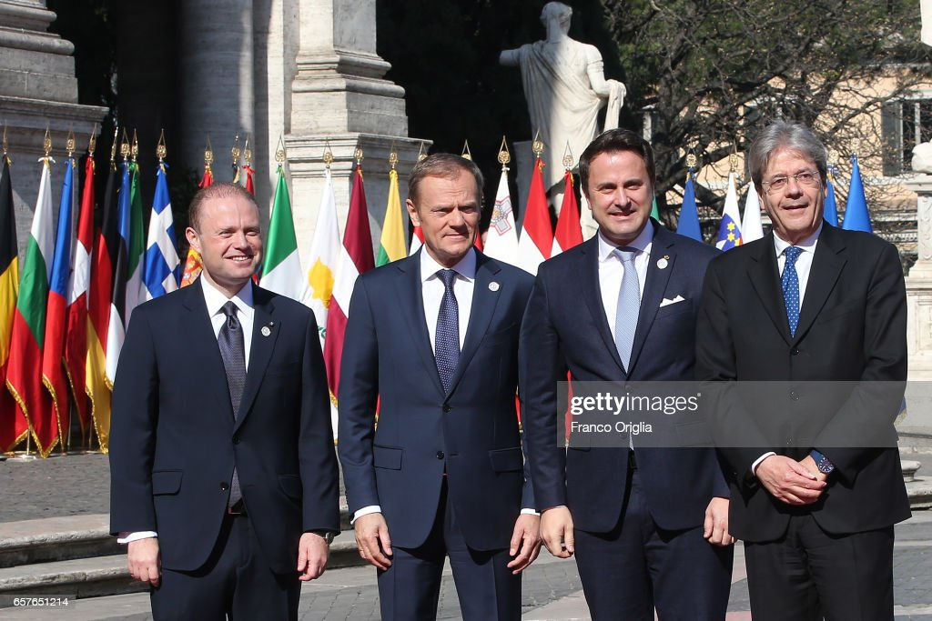 Malta's Prime Minister Joseph Muscat, European Council President Donald Tusk, Luxembourg's Prime Minister Xavier Bettel and Italy's Prime Minister Paolo Gentiloni pose for pictures at the Capitole Hill ahead of a special summit of EU leaders to mark the 60th anniversary of the bloc's founding Treaty of Rome on March 25, 2017 in Rome, Italy. The 60th anniversary of the signing of the treaties creating the European Economic Community and the European Atomic Energy Community the first major structural steps toward creating the European Union.