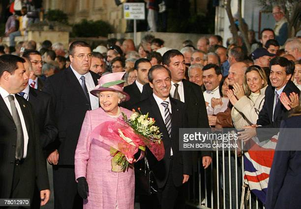 Malta's Prime Minister Lawrence Gonzi and Queen Elizabeth II of England walk together 20 November 2007 during a visit to Valletta The Queen and the...