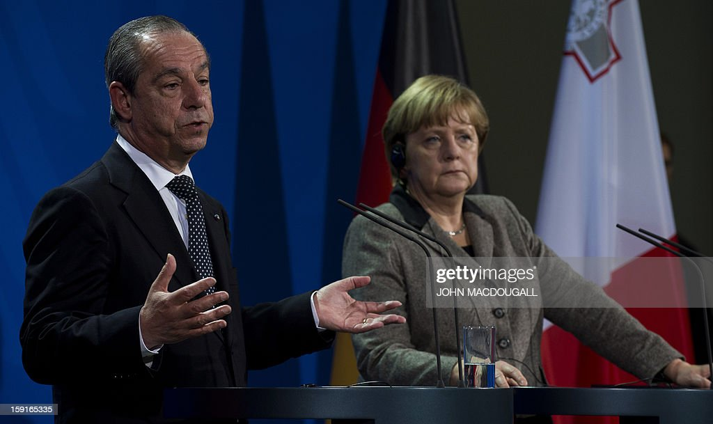 Malta's Prime Minister Lawrence Gonzi (L) speaks during a press conference with German Chancellor Angela Merkel (R) , following talks at the chancellery in Berlin, Germany on January 9, 2013.