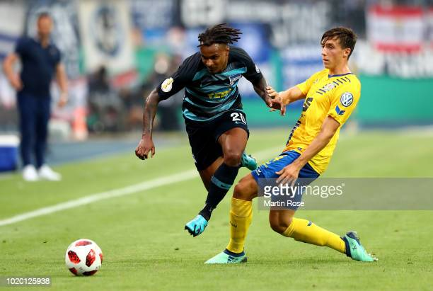 Ahmet Canbaz of Braunschweig and Niklas Stark of Berlin battle for the ball during the DFB Cup first round match between Eintracht Braunschweig and...