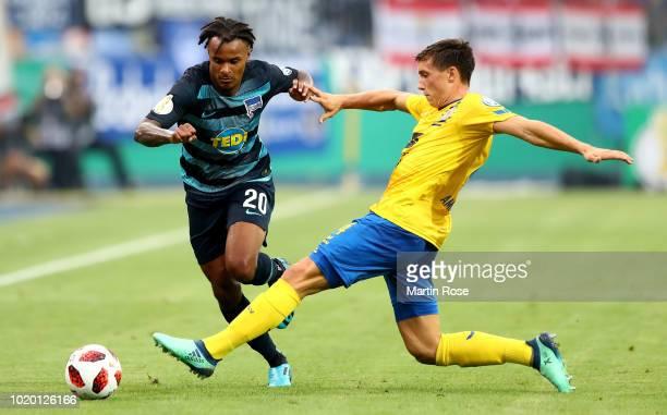 Malte Amundsen of Braunschweig and Valentino Lazaro of Berlin battle for the ball during the DFB Cup first round match between Eintracht Braunschweig...