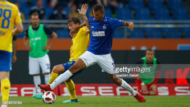 Malte Amundsen of Braunschweig challenges Daniel Gordon of Karlsruhe during the 3 Liga match between Eintracht Braunschweig and Karlsruher SC at...