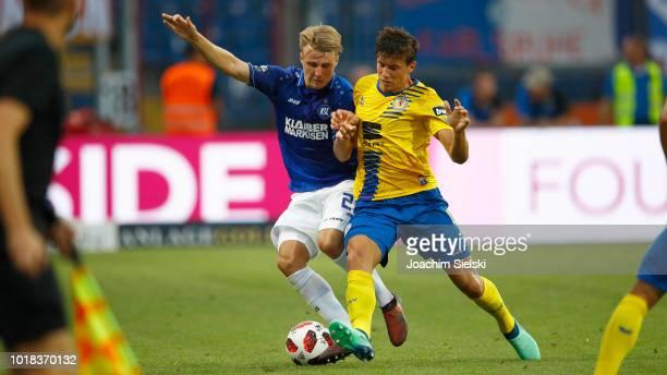Malte Amundsen of Braunschweig challenges Marco Thiede of Karlsruhe during the 3 Liga match between Eintracht Braunschweig and Karlsruher SC at...