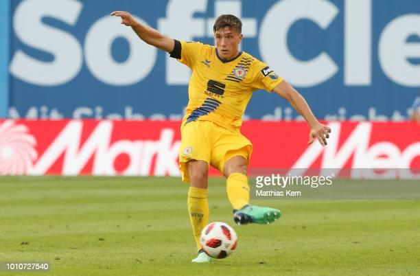 Malte Amundsen of Braunschweig runs with the ball during the 3Liga match between FC Hansa Rostock and Eintracht Braunschweig at Ostseestadion on...