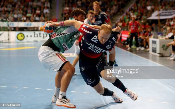 Malte Donker of HannoverBurgdorf challenges Anders Zachariassen of FlensburgHandewitt during the Liqui Moly HBL match between TSV HannoverBurgdorf...