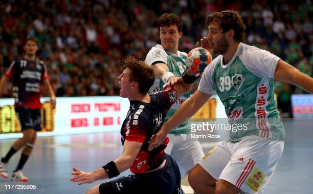 Malte Donker of HannoverBurgdorf challenges Goran Soegard of FlensburgHandewitt during the Liqui Moly HBL match between TSV HannoverBurgdorf and SG...