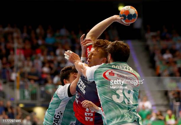 Malte Donker of HannoverBurgdorf challenges Simpon Jeppsson of FlensburgHandewitt during the Liqui Moly HBL match between TSV HannoverBurgdorf and SG...