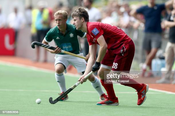 Malte Hellwig of HTC Uhlenhorst Muelheim challenges Benedikt Swiatek of RotWeiss Koeln during the mens final match between RotWeiss Koeln and HTC...