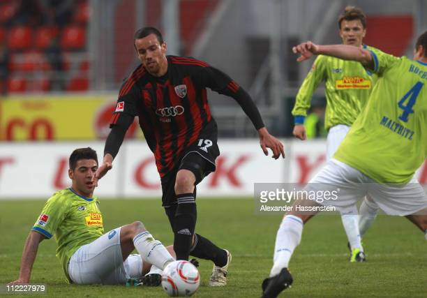 Malte Metzelder of Ingolstadt battles for the ball with Mirkan Aydin of Bochum and his team mate Marcel Maltritz during the Second Bundesliga match...