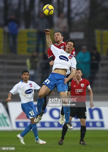 Malte Metzelder of Ingolstadt battles for the ball with Patrick Mayer of Heidenheim during the 3Liga match between FC Ingolstadt and 1 FC Heidenheim...