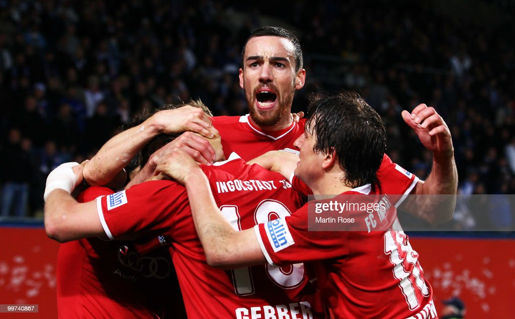Malte Metzelder of Ingolstadt celebrates with his team mate his team's 2nd goal the Second Bundesliga play off leg two match between Hansa Rostock and FC Ingolstadt 04 at DKB Arena on May 17, 2010 in Rostock, Germany.