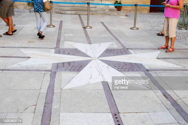 maltese cross decoated sidewalk in mdina - maltese cross stock photos and pictures