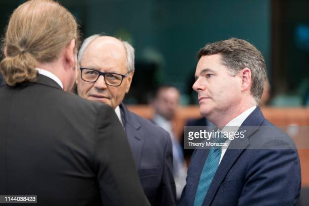 Maltese Finance Minister Edward Scicluna is talking with the Irish Minister for Public Expenditure and Reform Paschal Luke Donohoe prior the start of...
