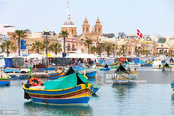 maltese fishing boats - marsaxlokk stock pictures, royalty-free photos & images