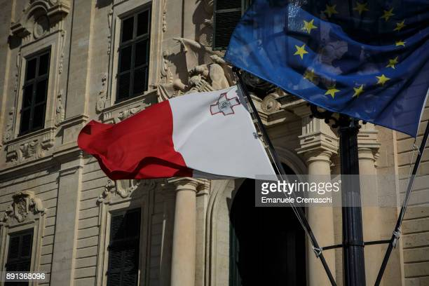 Maltese national flag and a European Union flag fly in front of the Auberge de Castille the official residence of the Maltese Prime Minister on...