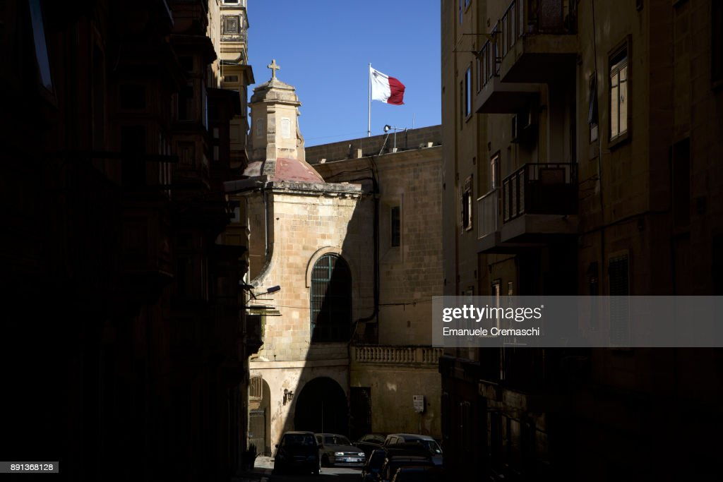 A Maltese national flag flies over the bastion of the Valletta waterfront on December 9, 2017 in Valletta, Malta. Valletta, a fortified town that dates back to the 16th century, is the southernmost capital of Europe and a UNESCO World Heritage Site: together with all the Maltese islands, it will be hosting the title of European Capital of Culture in 2018.