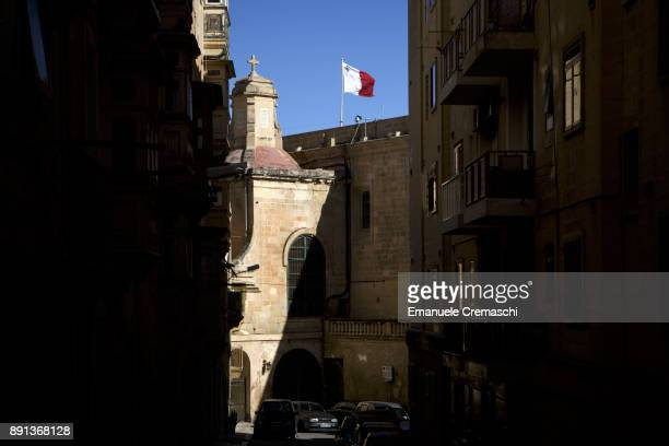 Maltese national flag flies over the bastion of the Valletta waterfront on December 9 2017 in Valletta Malta Valletta a fortified town that dates...