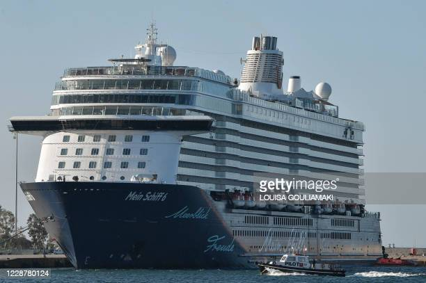 Maltese-flagged cruiser Mein Schiff 6, operated by German travel giant TUI is docked at the port of Piraeus early on September 29, 2020 after a dozen...