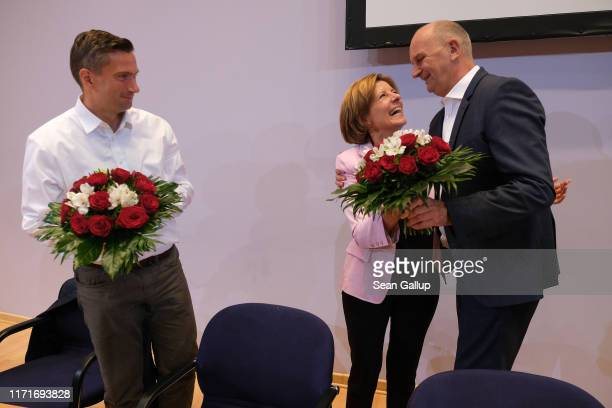 Malu Dreyer, co-deputy leader of the German Social Democrats , gives flowers to Martin Dulig , lead candidate of the SPD in Saxony state elections,...