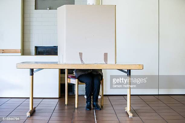 Malu Dreyer incumbent governor of RhinelandPalatinate and member of the German Social Democrats sits in the polling booth to cast her ballot in...